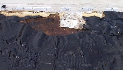 Missing EPDM Exposes Wood